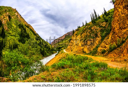 Mountain trail near the stream. Mountain river canyon view. River stream in mountains
