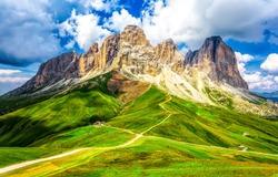 Mountain trail on green hill landscape