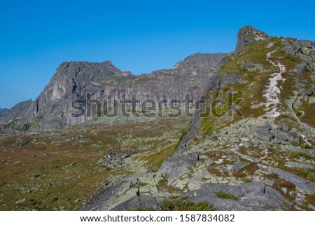 mountain trail to rock top and cliff, hiking and mountaineering on mountain ridge, symbolizes path to success, perseverance in achieving goals