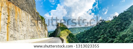 Mountain traversed by road in the way Villeta - Bogota, Cundinamarca framed by rock and forest #1313023355