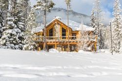 Mountain vacation log houses at ski resort or golf course. Winter wonderland.