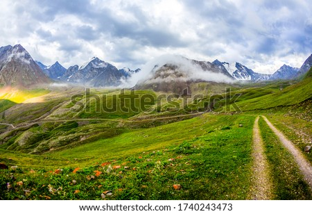 Mountain valley cloudy sky landscape. Mountain valley view. Valley in mountains
