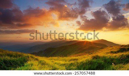 Mountain valley during bright sunrise. Beautiful natural landscape #257057488
