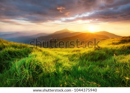 Mountain valley during sunrise. Beutiful natural landsscape in the summer time. #1044375940