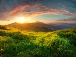 Mountain valley during sunrise. Natural summer landscape