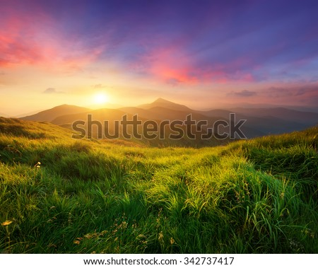 Mountain valley during sunrise. Natural summer landscape #342737417
