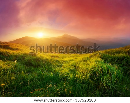 Mountain valley during sunrise. Natural summer landscape #357520103
