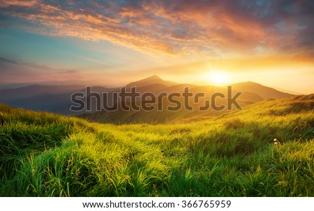 Mountain valley during sunrise. Natural summer landscape #366765959