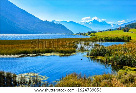 Mountain valley lake water landscape. Lake in mountains. Mountain valley lake. Lake in mountain valley