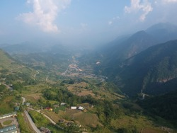 Mountain valley landscape. Mountain rocks in mountain valley panorama. Mountain valley view. Sapa mountains and forest aerial view