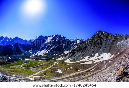 Mountain valley peak snow landscape. Sun in mountains. Mountain sun view