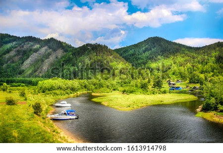Mountain valley river boats view. River boats in mountain river. Mountain river valley landscape