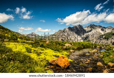 Mountain valley river creek landscape. Cold creek in mountain valley. Mountain valley creek water. Creek in valley mountains