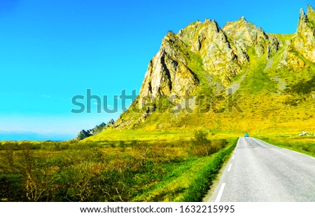 Mountain valley road scene. Road in mountain valley. Mountain road. Mountain valley road view
