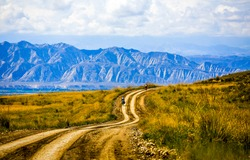 Mountain valley rural road landscape. Road in mountain valley. Mountain road in valley