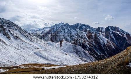 Mountain valley snow panoramic landscape. Winter mountain snow peaks panorama. Mountain snow panorama. Mountain panoramic landscape