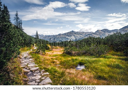 Mountain valley trail landscape. Trail in mountains. Mountain trail view