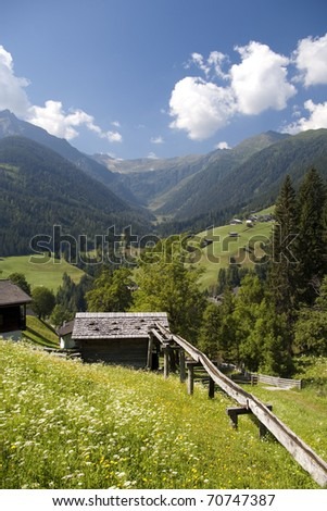 mountain valley village in austrian alps in summer by lesachtal in kaernten province