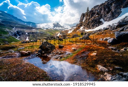 Mountain valley water landscape. Mountain hill valley snow. Valley snow in mountains. Mountain landscape snow