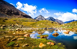 Mountain valley with a water source. Mountain water. Water in mountains. Mountain valley water
