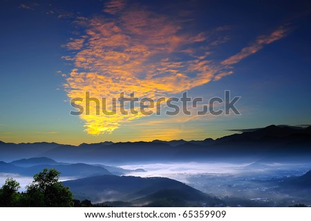 mountain valley with beautiful cloud in the sky at dawn