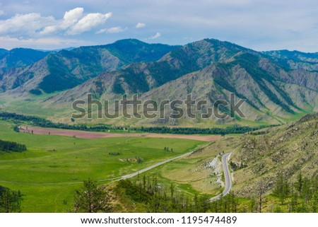 Mountain valley with the road below. Mountain landscape from a height. Altai #1195474489