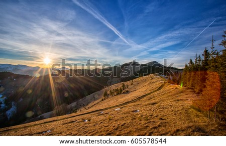 Mountain view at sunset with cloudy sky. Dramatic sky. beautiful background