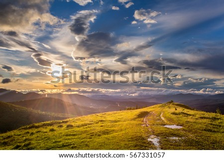 Mountain view at sunset with cloudy sky. Dramatic sky. beautiful nature background #567331057
