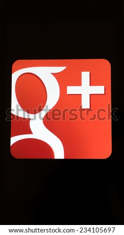 MOUNTAIN VIEW CA USA NOV 17 2014 Closeup photo of Google plus icon on a mobile phone screen Gmail is a social networking service by Google