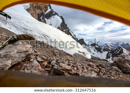 Mountain View from Yellow Tent.\ Landscape from Camping Tent Vanishing Point Steep Glacier Tongue  Ice and Rock Cliff Terrain Alpine Gear