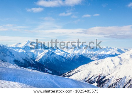 Mountain view on a ski slope with pisten bully traces #1025485573