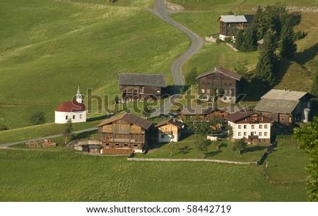 mountain village in austrian alps in morning light