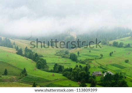Mountain village in  Carpathian, Ukraine. - stock photo