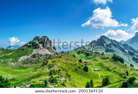 Mountain village on the green hills. Green hills in mountains. Mountain green landscape. Mountain panorama