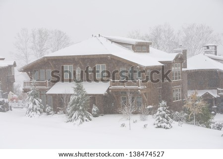 Mountain villas during a snow storm, Stowe, Vermont, USA