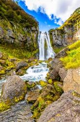 Mountain waterfall mossy rocks view
