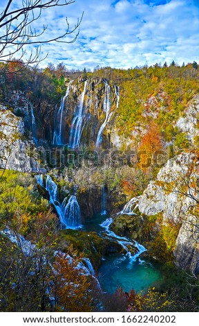 Mountain waterfall river canyon in autumn. Autumn mountain forest waterfall