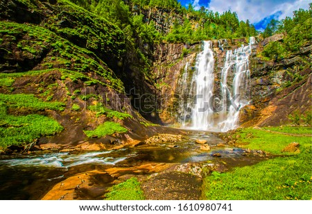 Mountain waterfall river stream view. Forest waterfall in mountains. Mountain forest waterfall landscape