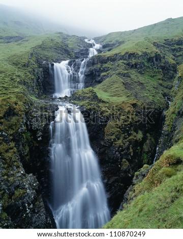 Mountain with waterfall - stock photo