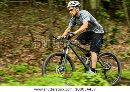 mountainbiker downhill on a trail