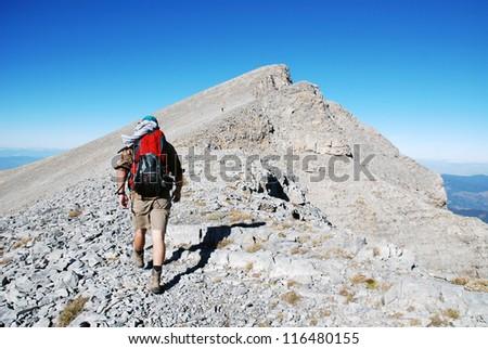 Mountaineer climb to the high mountain peak