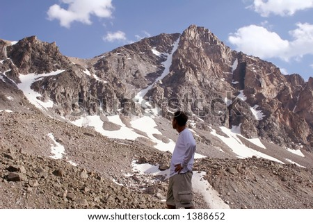 Mountaineer studying Whitetail Peak, Montana.