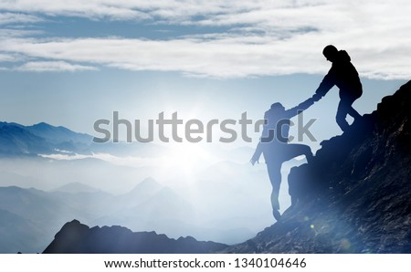 Photo of  Mountaineers help each other to reach the summit