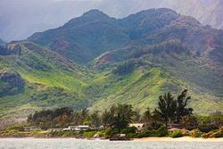 Mountainous east coast Oahu, Hawaii. Koolau Mountain Range above a few residences.
