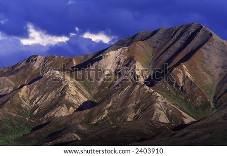 mountainous landscape with storm clouds