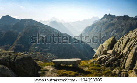 Mountainous panorma landscape view with big mountains. Mountain Pass in Switzerland. Autumn mood at sunset. Grimsel Pass links the Hasli Valley in the Bernese Oberland with Goms in Valais.  #1194058705