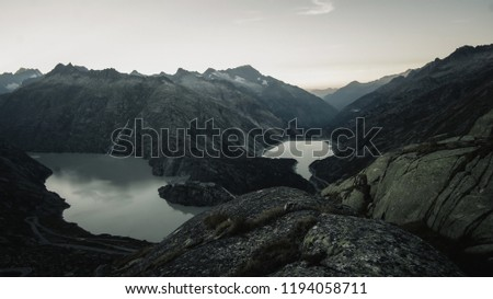 Mountainous panorma landscape view with big mountains. Mountain Pass in Switzerland. Autumn mood at sunset. Grimsel Pass links the Hasli Valley in the Bernese Oberland with Goms in Valais.  #1194058711