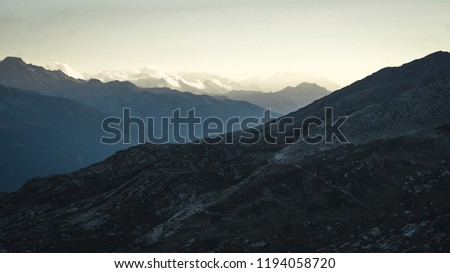 Mountainous panorma landscape view with big mountains. Mountain Pass in Switzerland. Autumn mood at sunset. Grimsel Pass links the Hasli Valley in the Bernese Oberland with Goms in Valais.  #1194058720