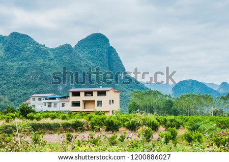 mountains and farm house scenery #1200886027