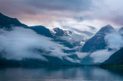 Mountains and lake in mist in the morning, Norway